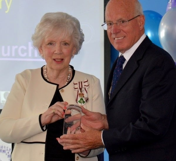 The Lord Lieutenant of County Antrim, Joan Christie OBE presents the Queen's Award for Voluntary Service to LEDCOM Chair Henry Fletcher. LEDCOM is the first enterprise centre in Northern Ireland to receive this prestigious Royal award.