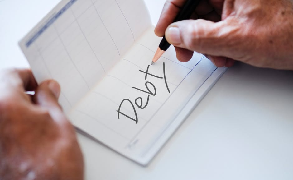 Being in Debt Stinks! 7 Ways to Get Out of Debt